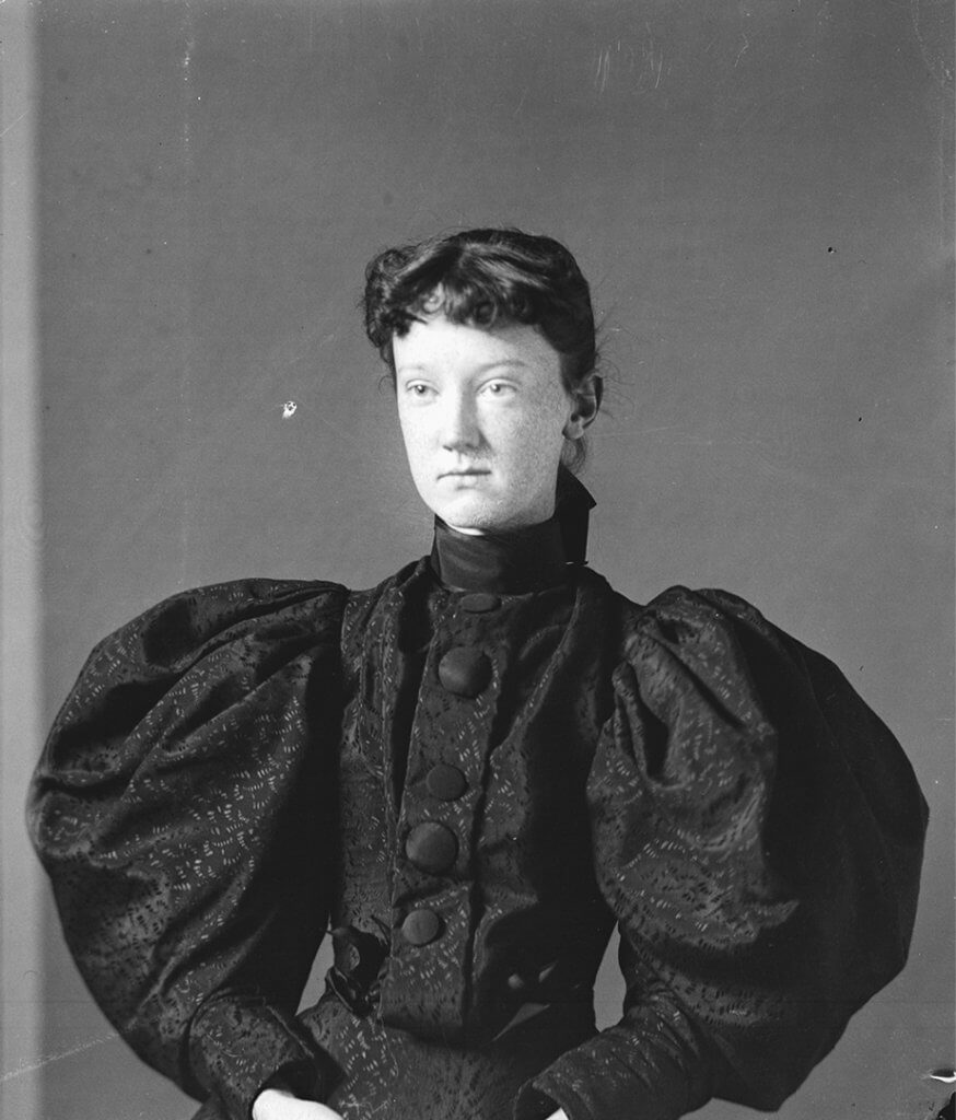Portrait of woman, Clara Parker, with dark hair and dress