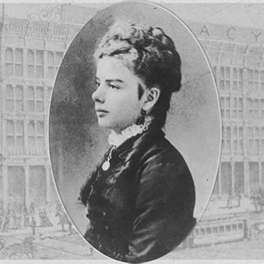 Portrait of woman in 19th century formal wear.